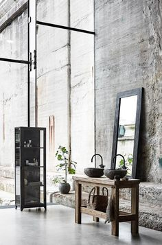 AW2016 collection from Muubs - raw Riverstone sink and iron cabinets in an industrial bathroom, concrete location - Hege in France