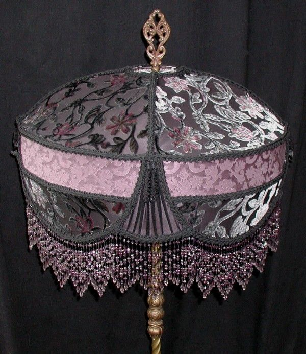 The  vintage style black trim and the six-inch amethyst and gray beaded fringe complete the lampshade.
