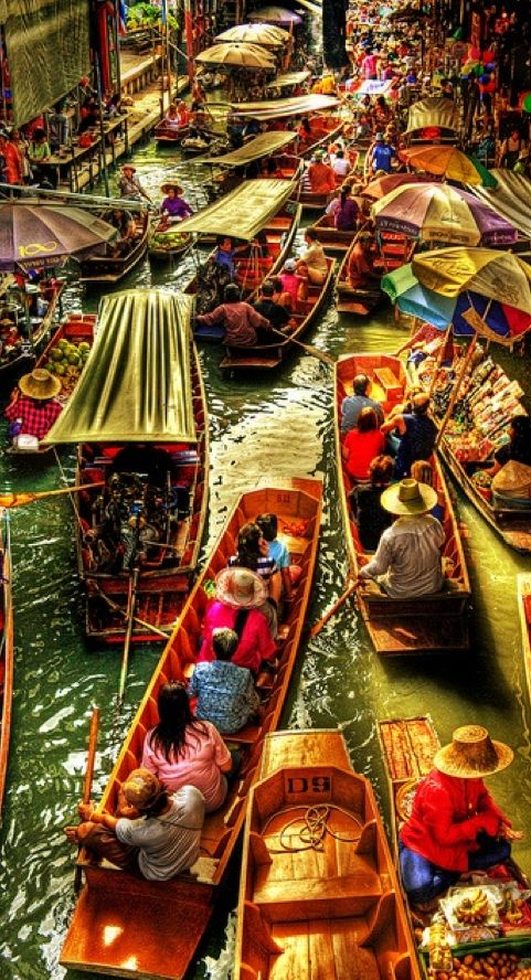 """Damnoen Saduak Floating Market inThailand • """"Arguably the most famous floating market in Thailand, it is located off Highway 325 about 110 kilometers southwest of Bangkok."""" • blogger: M.G. Edwards / http://worldadventurers.wordpress.com/2012/01/06/damnoen-saduak-floating-market-in-thailand/ • photo: """"Gridlock"""" by Andy Bracey on Flickr • Note: The canal scene from the James Bond movie, """"The Man with the Golden Gun"""" was filmed here"""