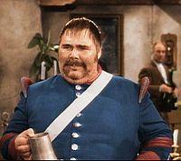Henry Calvin as Sergeant García, with Gene Sheldon as Bernardo in the background in Zorro.