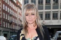 "Ronnie Wood's ex-wife Jo Wood has always been ""open and honest"" about drugs with her four children and tried to educate them about life"