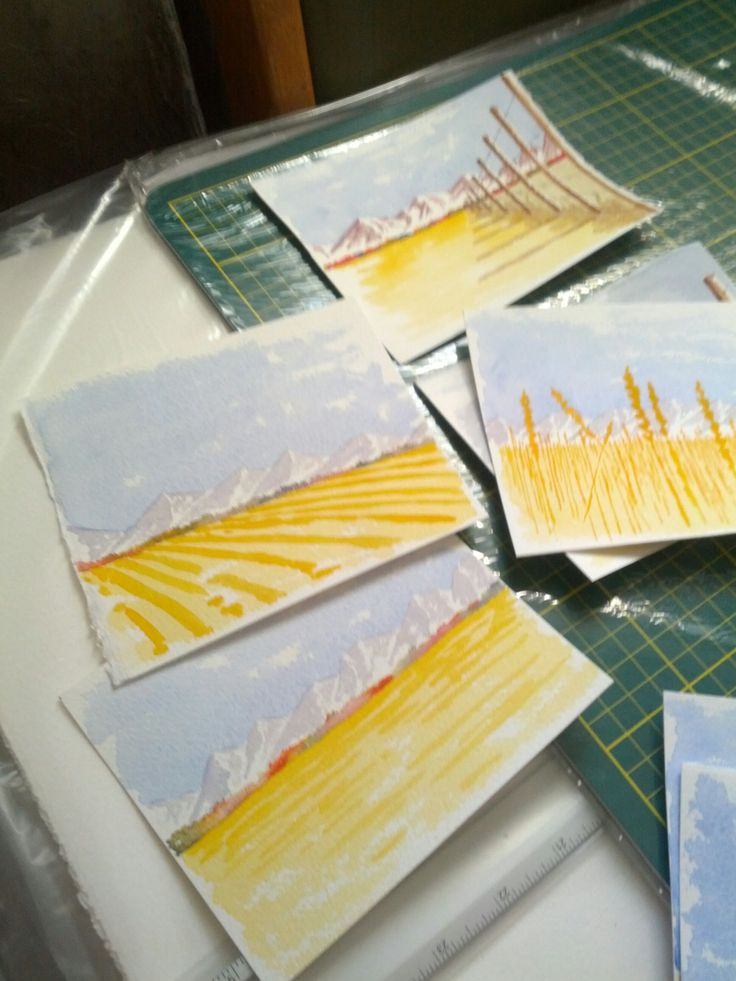 an assortment of small watercolours being created