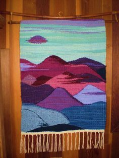 """""""Mountain Spirit Dance"""" ... Handwoven in the Rio Grande Tradition (Hispanic) with 100% hand-dyed wool on a large floor walking loom. This style of weaving was brought to the Southwest by Spanish settlers in the 16th century and is traditional to the people of the middle and upper Rio Grande valleys in New Mexico and Southern Colorado, where I make my home. This style actually derives from the interweaving of the Spanish, Mexican native, and the local Indian pueblo weaving cultures."""