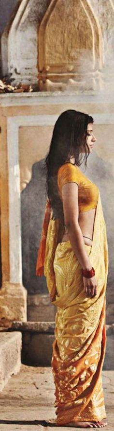 Indian woman in yellow saree
