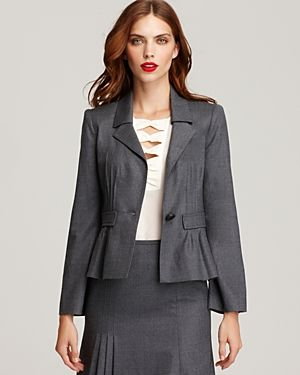 The top might be too revealing for court, but the pleats on the jacket and skirt make this gray suit special.