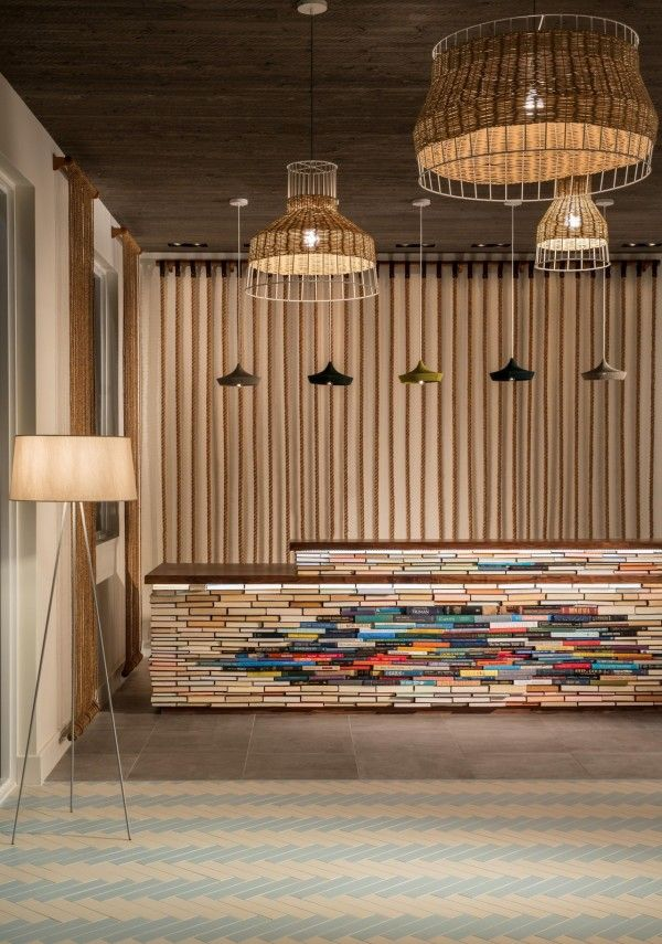 Fabulous reception desk at the Postcard Inn Hotel in the Florida Keys. It's made of books--spine in and out to create a lovely texture, pattern, and color.