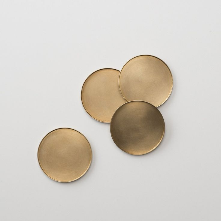 Made from solid brass and hand-finished in our factory, these coasters have a natural living finish that will evolve and darken with use. Lightly coated with wax and featuring a cork base, they will a