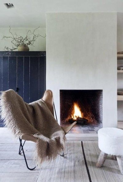 Blend light browns, beiges and woody colours with white and grey and navy accents for a harmonious winter palette. #FieldNotes #Winter #Fireplace #InteriorScheme #Styling