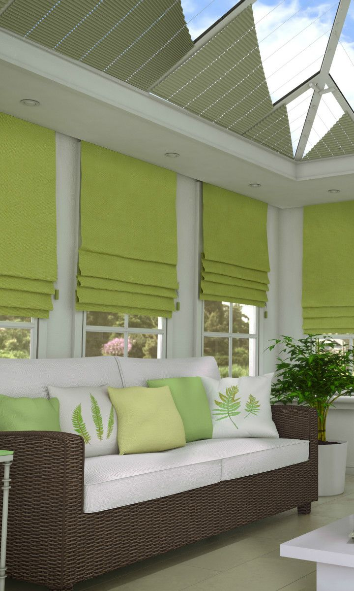 Natural hues work well in conservatories. By teaming up accessories and furniture with a contrasting bright colour of your blinds, you can really make an impact