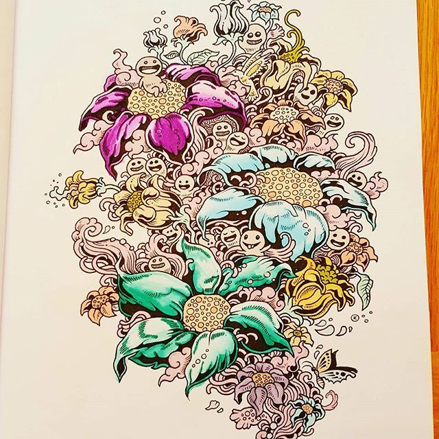 Cute colouring book page, which has been coloured in by