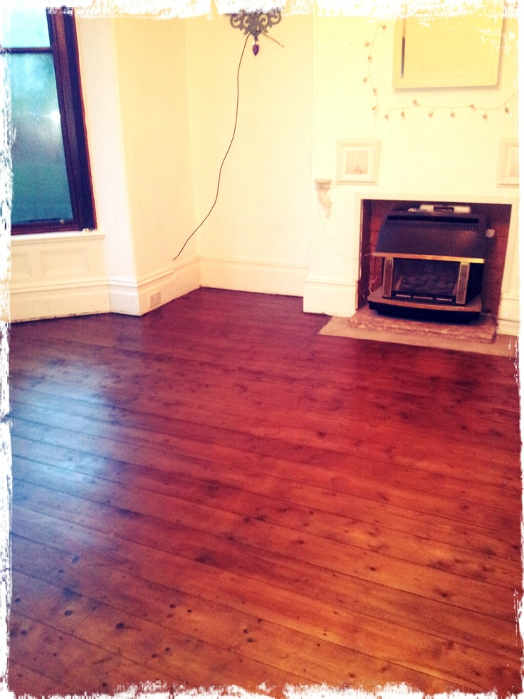 Living room floor after being sanded and stained