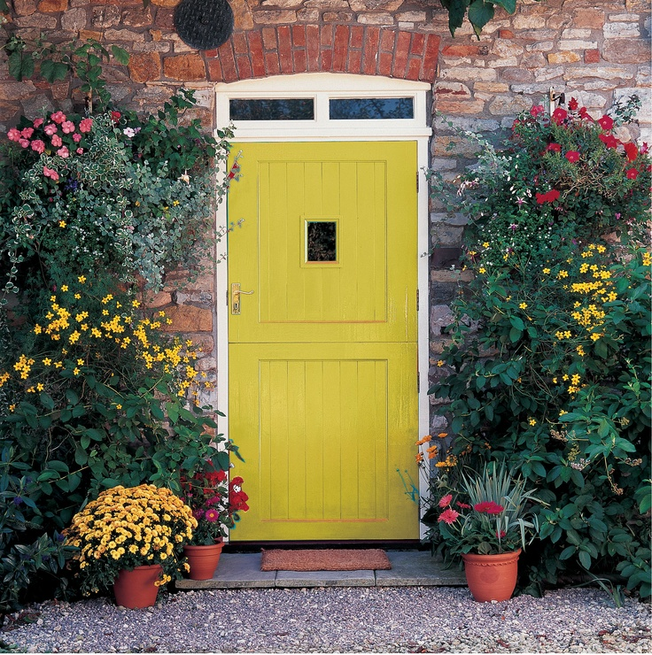 Coordinate the colour of your front door with plants around your entrance for an on trend look and to make a bold statement.