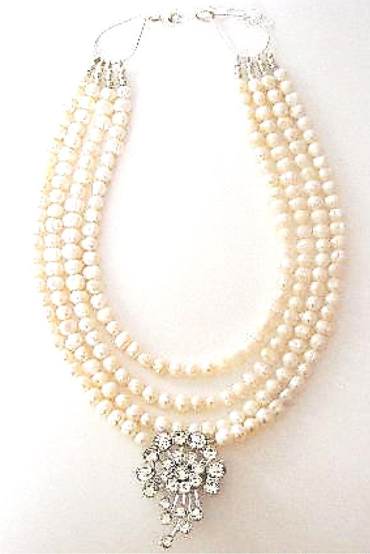 White freshwater pearl & Pendant vintage flower necklace.  One-of-a-kind  statement necklace handmade with white freshwater pearls paired with vintage brooch $250,00. #freshwaterpearl#handmadenecklace#statementnecklaces#necklaces