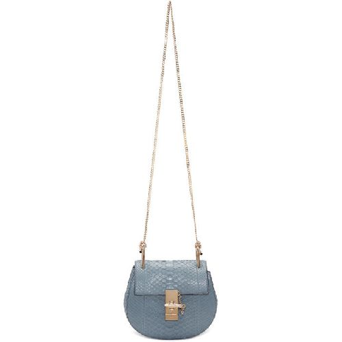"Python saddle bag in cloudy blue. Curb chain shoulder strap. Foldover flap with logo-engraved slide-lock fastening. Patch pocket at interior. Buffed leather lining in pale pink. Pale gold-tone hardware. Tonal stitching. Approx. 7.5"" length x 7"" height x 2.75"" width. Python,"