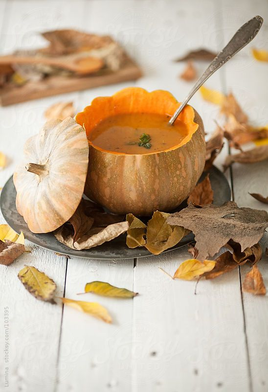 Pumpkin soup served beautifully in a pumpkin.