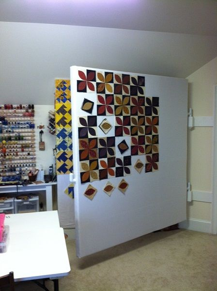 Hinged design wall. I ran out of wall space, so I may have to add more walls! I never have just one quilt going, usually 4 or 5.  ((I MUST have this!))