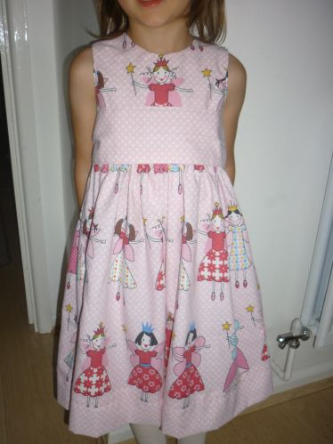 Beautiful Cottage Mama Party Dress, written up on my blog. Upcycled fabric :)