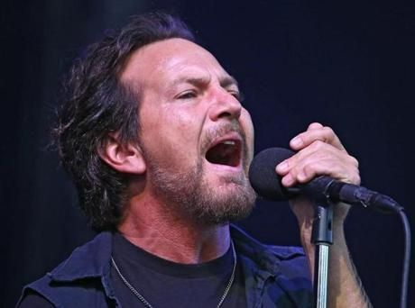 Eddie Vedder, lead singer with Pearl Jam, performed in concert with his band at Fenway Park on Friday.