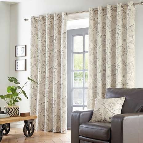 Designed with a floral motif in shades of grey on a natural background, this pair of cotton curtains features an eyelet header to easily attach to your curtain ...