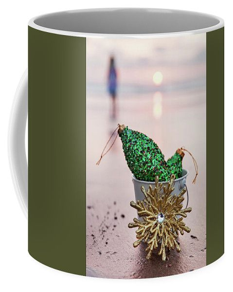 Coffee Mug featuring the photograph At Sunset In California by Evgeniya Lystsova. Christmas Decorations collected in a white bucket with Golden Snowflake at sunset on the background of beach and sea, holiday concept. Christmas is the time of giving and receiving gifts. Coffee Mugs are great choice for a special gift. More options of Art Products (Prints, Home Decor, Lifestyle) you can find in my gallery. #EvgeniyaLystsovaFineArtPhotography #Christmas #Gifts #Season #Mugs #HomeDecor #Kitchen