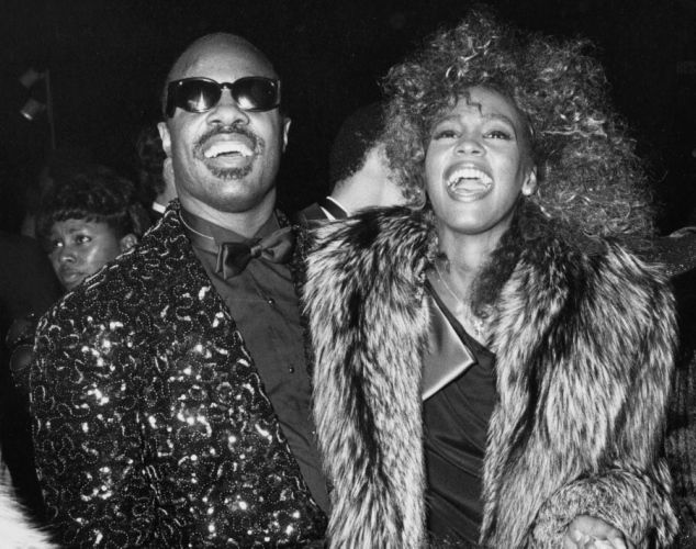 Musician Stevie Wonder and singer Whitney Houston attending 13th Annual American Music Awards on January 27, 1986 at the Shrine Auditorium in Los Angeles, California.