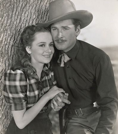 """Dodge City"" (1939) - Olivia de Havilland and Errol Flynn - Directed by Michael Curtiz - Warner Bros."