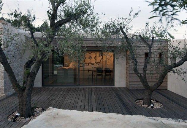 Italian architect Luca Zanaroli has designed a contemporary remodel and extension of a saracen trullo, a common rural building found in the Ostuni region of Italy.