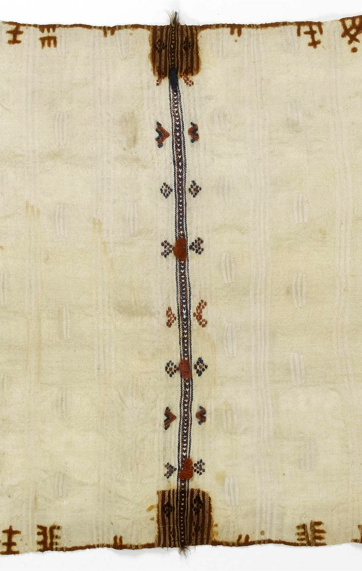 Africa | Detail from a Berber cape / shawl from the Anti Atlas Mountain region, Morocco | Wool; The cream ground woven with cream stripes and dashes, dyed with henna motifs along the long borders, the central section divided by a band of woven and embroidered decoration with terracotta and blue wool bobbles, the end borders similarly decorated