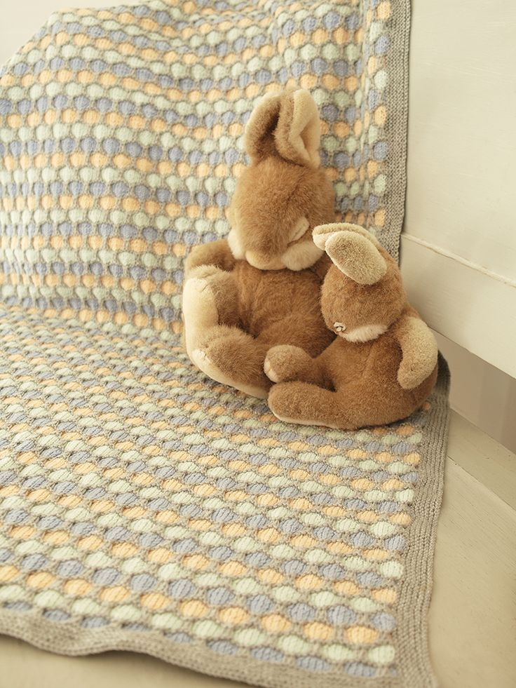 Farrow - Knit this cosy coloured blanket from the Baby 4ply collection. Designed by Vicky Sedgwick using a slip stitch honeycomb pattern. This design is suitable for beginner knitters.