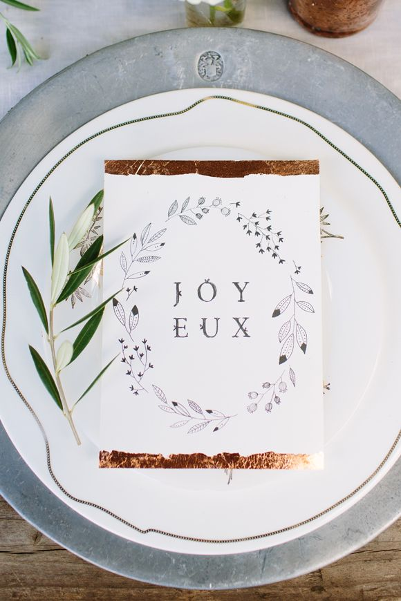 christmas table setting with olive branch and gold leafed card