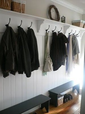Bracket, shelf and hooks along hallway.