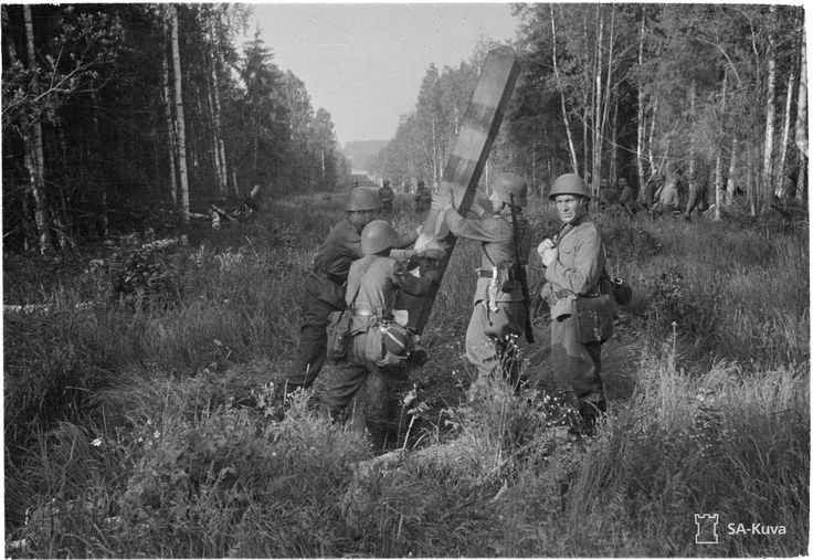 Finnish soldiers reach the Russian-Finnish border, and tear down the Soviet border post before pushing eastward.