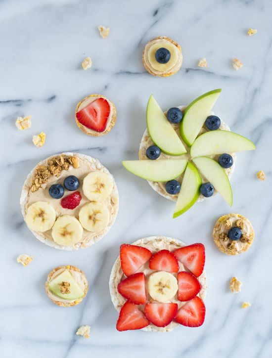 """Healthy Peanut Butter Yogurt Fruit Pizzas. Rice cakes spread with peanut butter """"sauce"""" and topped with fresh fruit."""