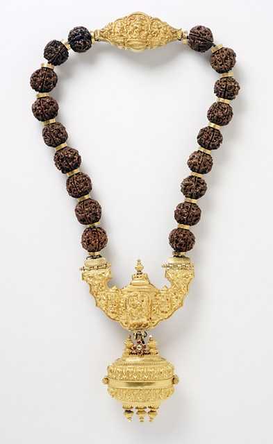 India, Tamil Nadu | Necklace with Shiva's Family, late 19th century  |  Gold inlaid with rubies and a diamond; Rudraksha (eye of Rudra/Shiva) beads (elaeo carpus seeds)