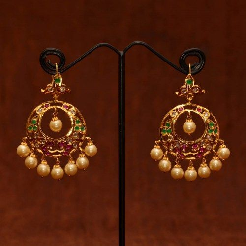 Anvi's chand bali studded with uncut stones, rubies and emeralds with pearl hangings