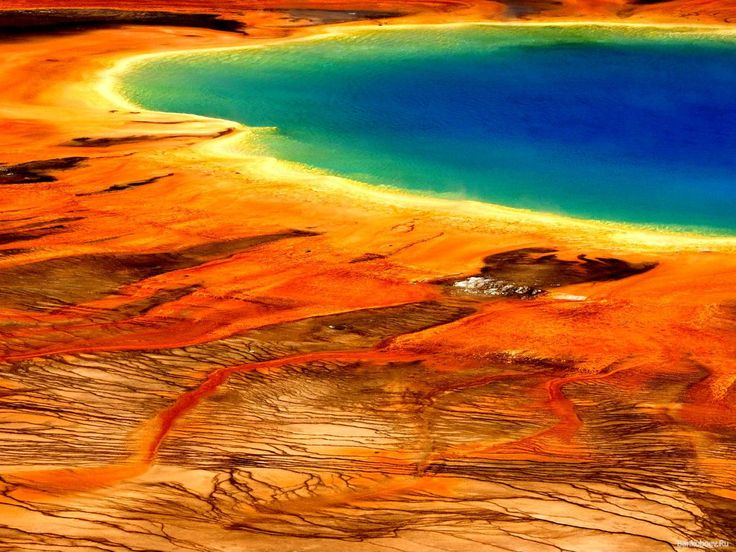 Grand Prismatic Spring, Wyoming - Yellowstone Park's largest hot spring is known for its striking rainbow effect.