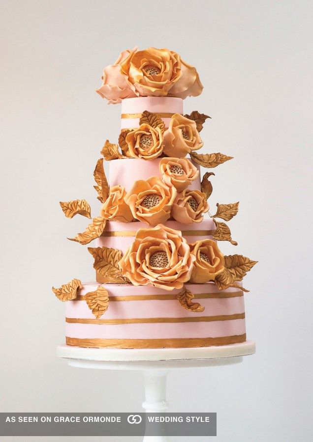 Blush pink fondant and painted gold stripes embellished with handmade sugar fantasy roses // Pinned by Dauphine Magazine x Castlefield - Curated by Castlefield Bridal Company & Branding Atelier and delivering the ultimate experience for the haute couture connoisseur! Visit www.dauphinemagazine.com, @dauphinemagazine on Instagram, and @dauphinemag on Pinterest • Visit Castlefield: www.castlefield.co and @ castlefieldco on Instagram / Luxury, fashion, weddings, bridal style, décor, travel, art
