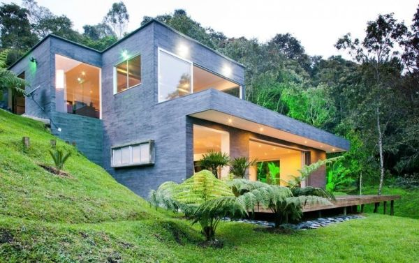"""Residential Architecture: House Lago en el Cielo by David Ramirez: """"located less than 30 minutes from Medellin, Colombia..projected in two levels lets you enjoy a privileged view over La Fe dam, and its location on the land was conceived to allow you to be in touch with nature..from outside an orthogonal volumetry with a moderate proportion and quite façade. Its skin veneered with precast concrete similar to the blackboard. Density is balanced with big glass windows and super imposing…"""