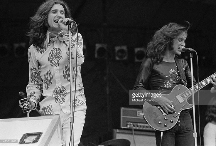 Guitarist Dave Davies and singer-songwriter Ray Davies performing with The Kinks at the White City Festival, White City Stadium, London, 15th July 1973.