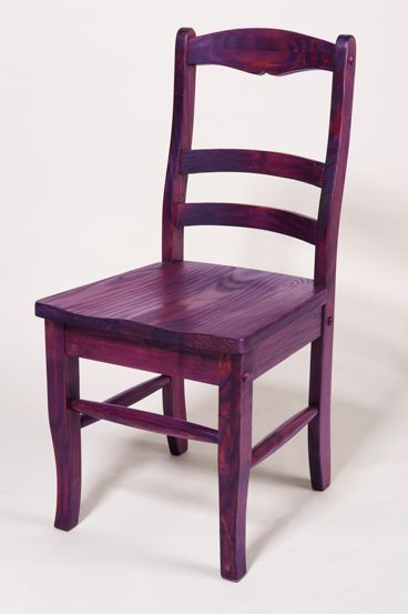 Rit Dye can be used to stain unfinished wood and gives colorful results, allowing the natural wood grain to show through. This chair is made of pine, which is a soft wood that absorbs the dye beautifully. Colorful chairs will instantly brighten a breakfast nook or family room. It's so easy and fun to add colorful accents to your decorating!