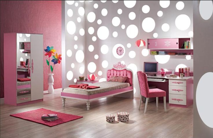 Super cute girl's room with a glowing poke a dot wall.