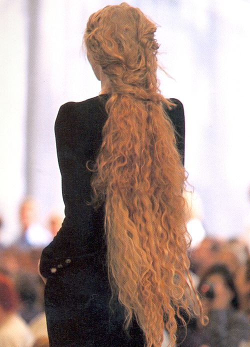 super long straight hair is unusual but such super long curls are extremely rare