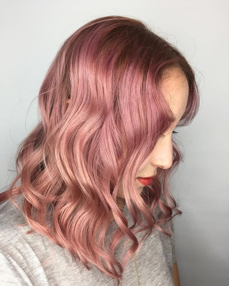 Gorgeous wavy rose gold pink Aveda hair color by stylist Sara at Ultra Lux Salon.