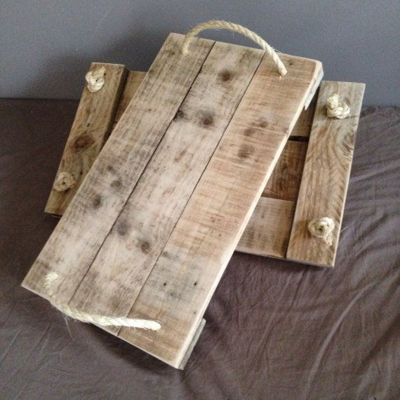 This tray is perfect for a casual dinner on the sofa, breakfast in bed or serving with a touch of rustic charm.  These trays have been handcrafted from reclaimed timber, sanded down to a smooth finish and treated with a clear wax to protect and enhance the natural grain of the wood. I can apply a darker wax to bring a different feel to the trays should you wish.  To finish them off rope handles are attached which adds to the rustic / natural charm of the tray.  These are lovely items of…