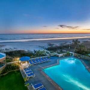 Ocean Isle Inn, Ocean Isle Beach, NC Off-season rates drop to the $80 range for oceanfront rooms at Ocean Isle Inn, on a private stretch of sand halfway between Wilmington, NC, and Myrtle Beach, SC. Winter temperatures hover in the 50s, but swimming remains a pleasure at the heated indoor pool and Jacuzzi spa. Head to Wilmington and visit Fort Fisher Aquarium, or take a tour of the historic buildings on the waterfront.