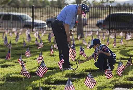 Monday Motivations 5/28: United States Marine Corps veteral William Allen, left, assists 9-year-old cubscout Brenden Kirgan, of Las Vegas, as they place flags above headstones at the Southern Nevada Veterans Memorial Cemetery, Saturday, May 28, 2011, in Boulder City, Nev.: Ideas, Flags, Mondays Motivation, Scouts, Memories, Marine Corps, Tigers, States Marines, Marines Corps