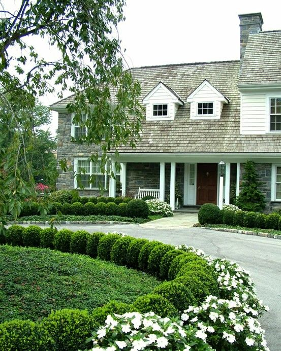 Stunning front entry with boxwood