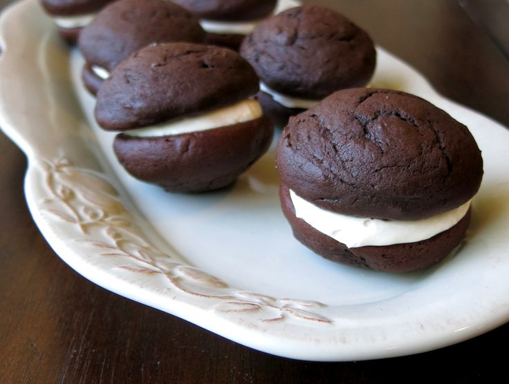 """Whoopie pie, also known as Moon pie, is a chocolate cookie that is more the texture of a cake.  How the cake cookie got its name - the Amish women would bake off leftover cake batter and make sandwich cookies out of them to pack in the husbands' lunch boxes.  When the men would open the lunch box and see the sandwich cookie they would yell, """"WHOOPIE!"""" If we saw these in our lunch boxes we'd say the same thing.  Continue reading →"""