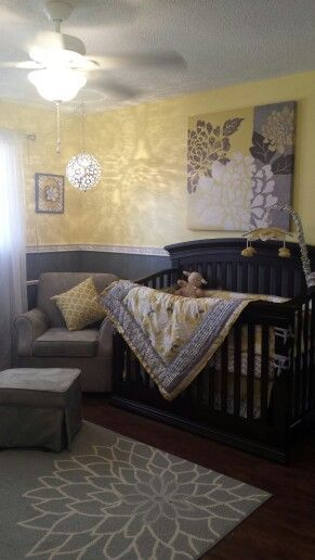 The Peanut Shell Stella yellow and grey nursery. Rug, chair rail and paint from Lowes. Bedding and crib Babies R Us. Wall decor Hobby Lobby. Chair from Wayfair.