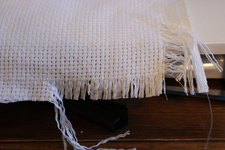 Finishing a Monks Cloth Afghan | After you've finished sewing all around the Monks cloth, you will pull ...